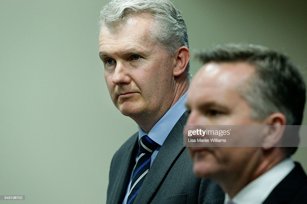 Shadow Minister for Finance <a gi-track='captionPersonalityLinkClicked' href=/galleries/search?phrase=Tony+Burke&family=editorial&specificpeople=1410357 ng-click='$event.stopPropagation()'>Tony Burke</a> and Shadow Treasurer Chris Bowen attend a press conference to announce Labor's Fiscal Plan on June 26, 2016 in Brisbane, Australia. Bill Shorten launched the Australian Labor Party Campaign in Brisbane and is campaigning heavily on Medicare, promising to make sure it isn't privatised if the Labor Party wins the Federal Election on July 2.