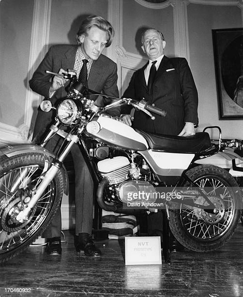 Shadow Minister for Industry Michael Heseltine examines a British 125 cc Norton Villiers Triumph motorcycle at a press conference at the RAC offices...