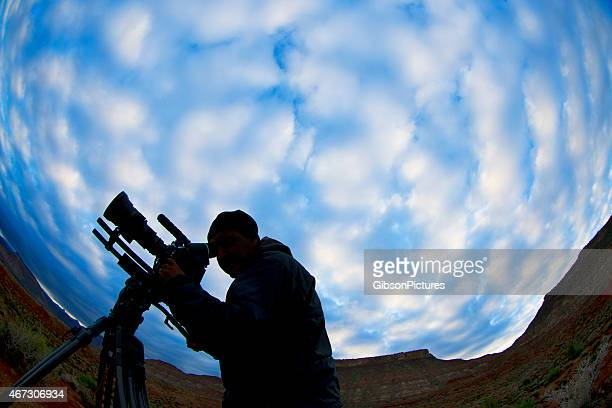 Shadow of a cameraman against a deep blue cloudy sky