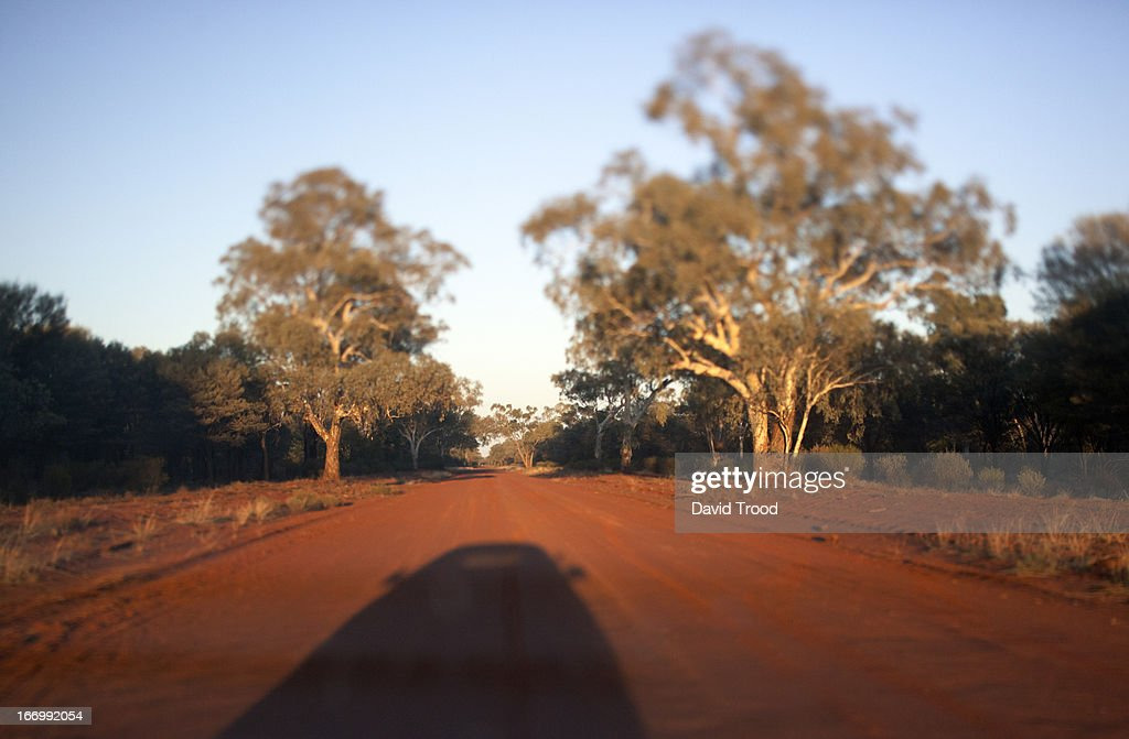 Shadow of a car on a dusty road. : Stock Photo