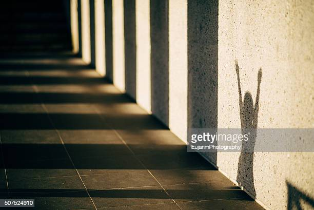 Shadow of a girl and pillars