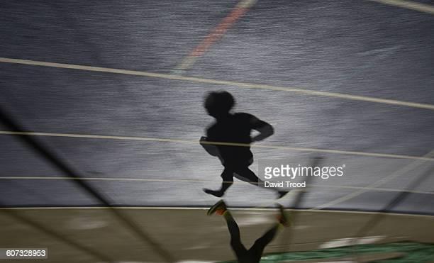 Shadow of a man running in sports stadium