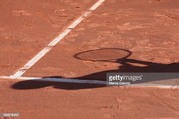 shadow of a tennis man