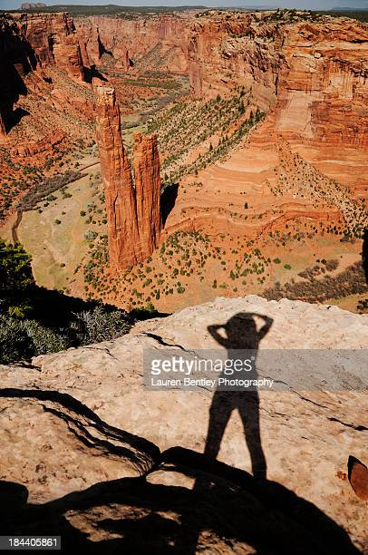 Shadow of a woman overlooking Southwestern Canyon