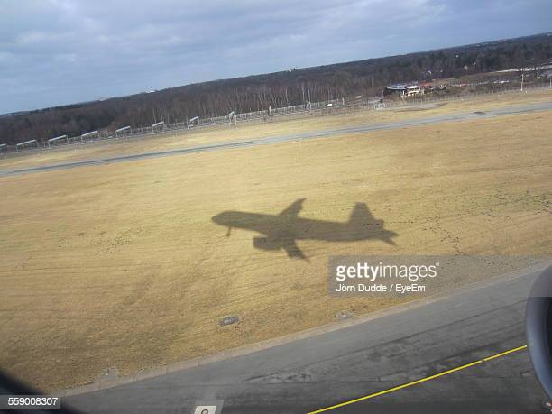Shadow Of Airplane Taking Off