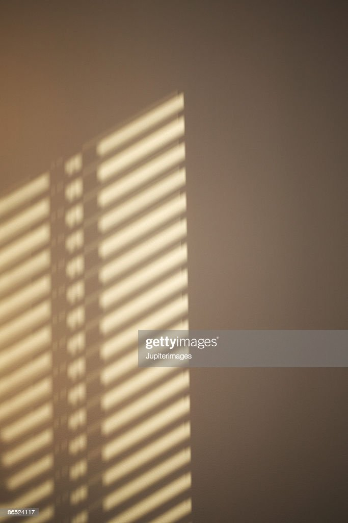 Shadow of blinds on wall