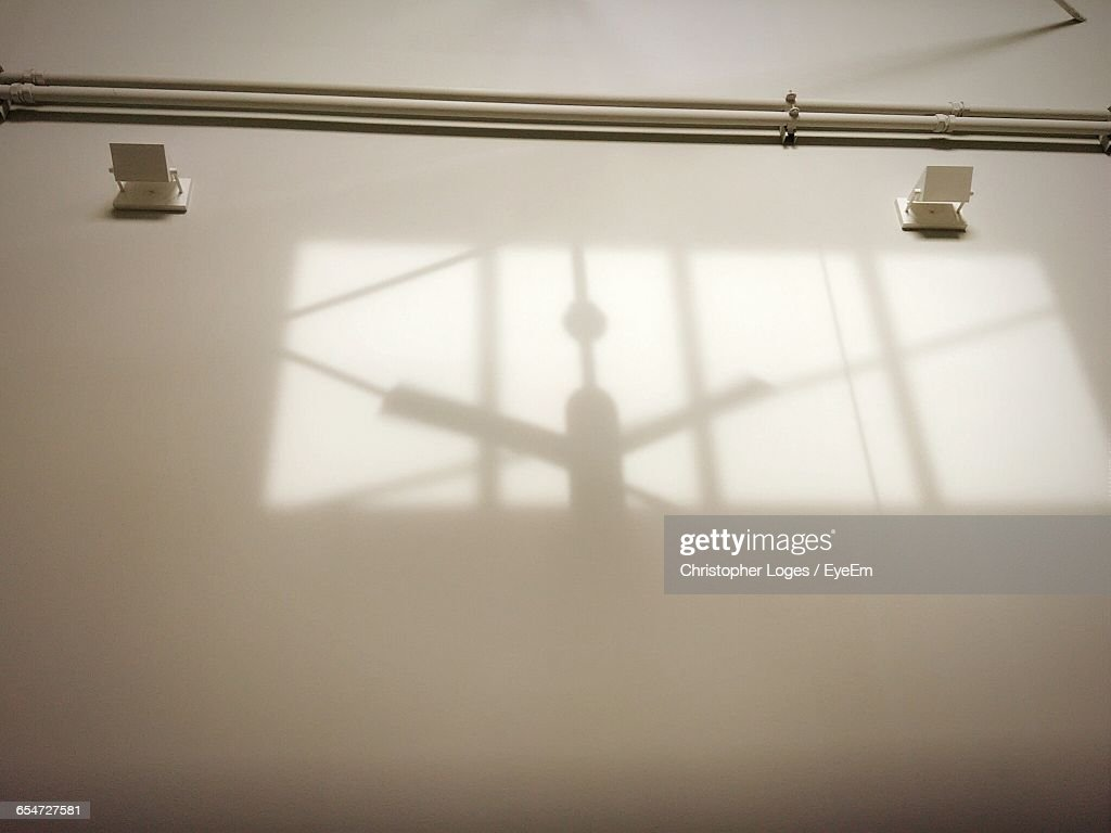Shadow Of Ceiling Fan On Wall At Home