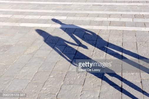 Shadow of couple holding hands : Stock Photo