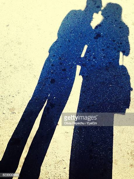 Shadow Of Couple Kissing On Street