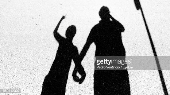 Shadow Of Father And Son Holding Hands On Street Stock ...
