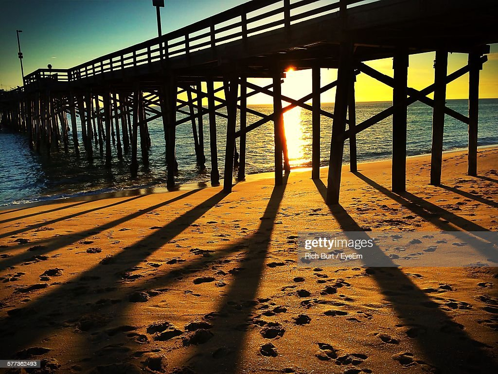 Huntington beach california stock photos and pictures getty images - Shadow Of Huntington Beach Pier Falling On Beach