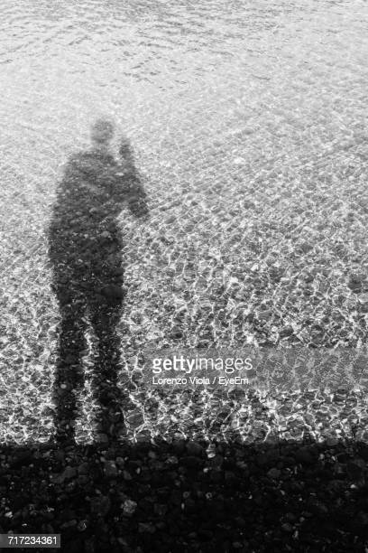 Shadow Of Man In Lake