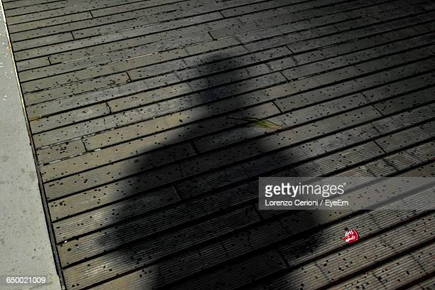 Shadow Of Man On Boardwalk At Night