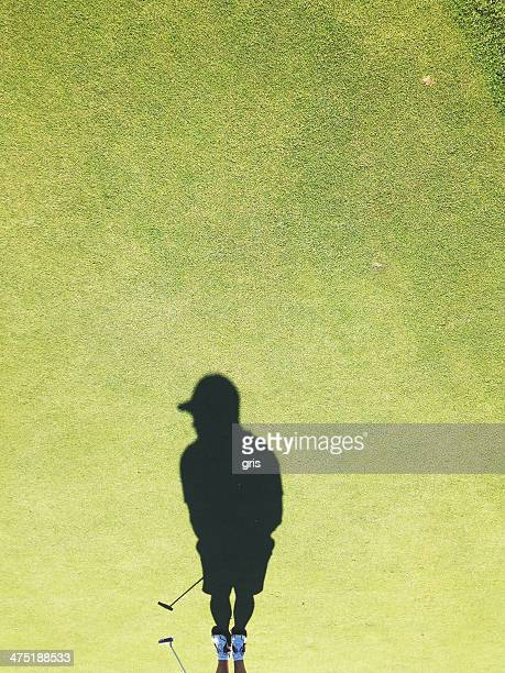 USA, Ohio, Montgomery County, Dayton, Shadow of golf player on golf course