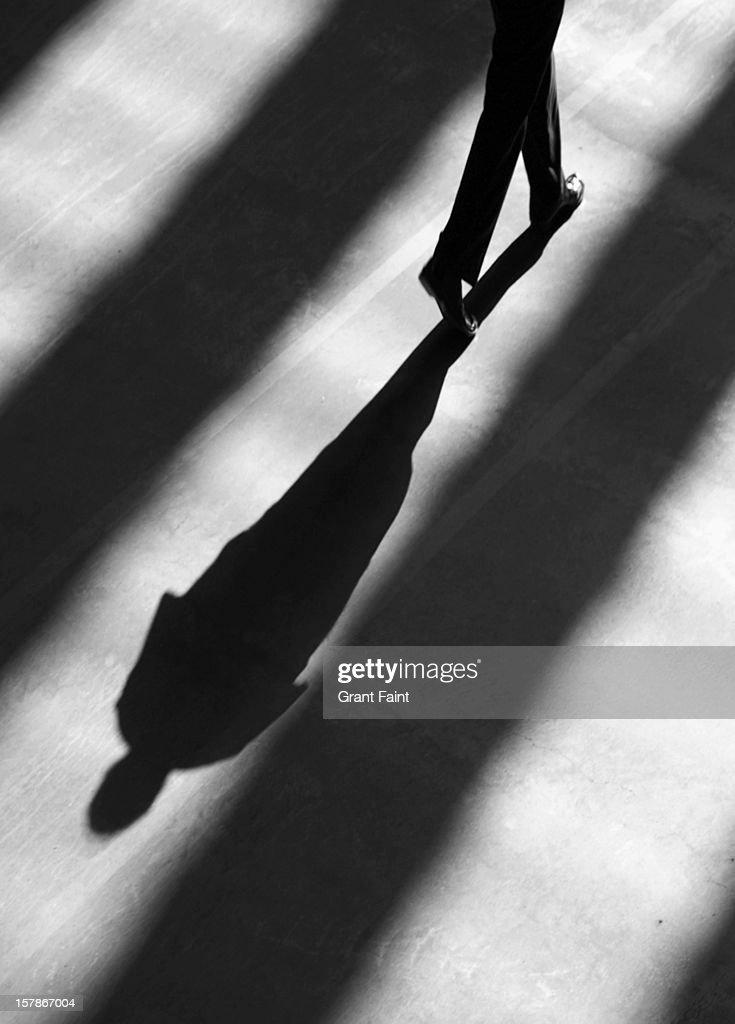 Shadow of man walking.
