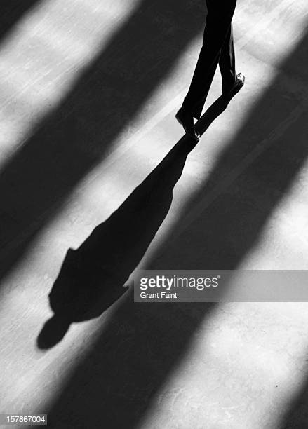 Shadow of man walking.