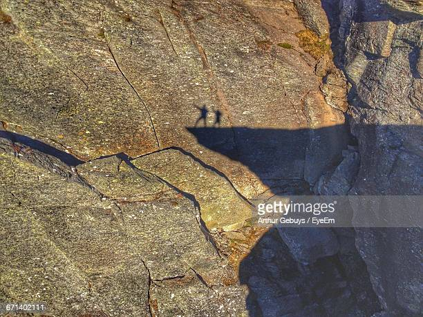 Shadow Of Men On Cliff Falling At Rocky Mountain