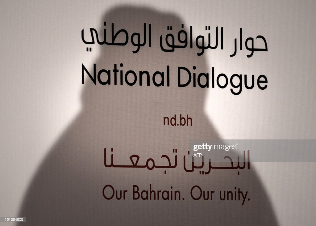 A shadow of national dialogue spokesperson, is seen on a banner during a press conference at the start of the National Dialogue in al-Areen Palace Hotel in Zallaq, South of Manama, on February 10, 2013. Bahrain's key political players began a new round of talks on Sunday to try to resolve the kingdom's two-year crisis, after opposition groups made a last-minute decision to join a national dialogue.