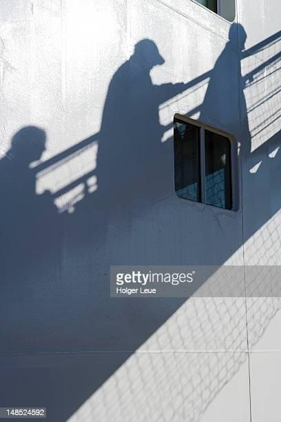 Shadow of passengers on gangway of cruiseship MS Astor (Transocean Kreuzfahrten).