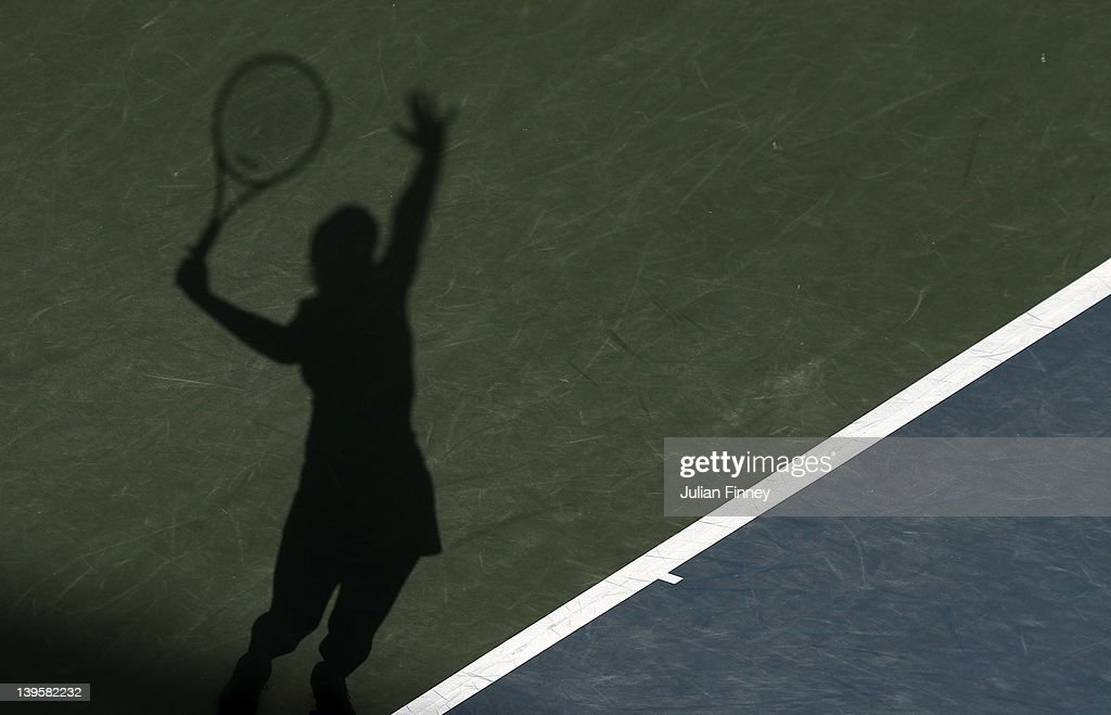 A shadow of <a gi-track='captionPersonalityLinkClicked' href=/galleries/search?phrase=Sabine+Lisicki&family=editorial&specificpeople=645395 ng-click='$event.stopPropagation()'>Sabine Lisicki</a> of Germany serving to Agnieszka Radwanska of Poland during day four of the WTA Dubai Duty Free Tennis Championship on February 23, 2012 in Dubai, United Arab Emirates.
