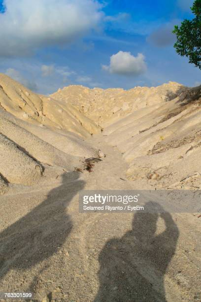 Shadow Of Sand On Landscape Against Sky