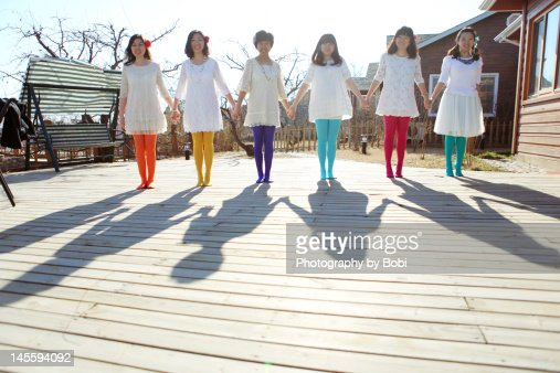 Shadow of six girls holding hands : Stock Photo