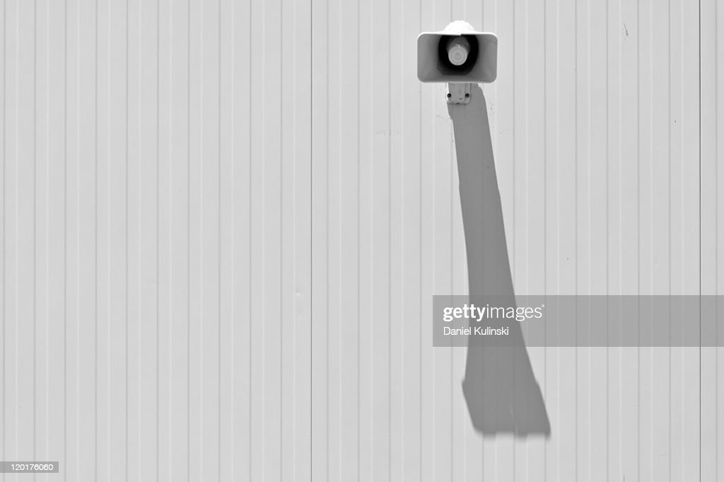 Shadow of speaker : Stock Photo