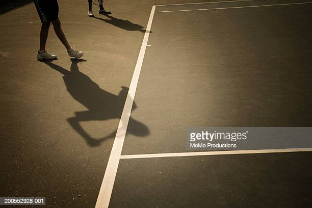 Shadow of tennis players