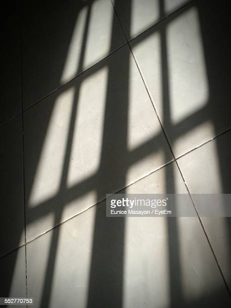 Shadow Of Window On Tiled Floor