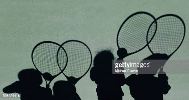A shadow of young fans is seen as they take part in Arthur Ashe Kids' Day prior to the start of the 2016 US Open at the USTA Billie Jean King...