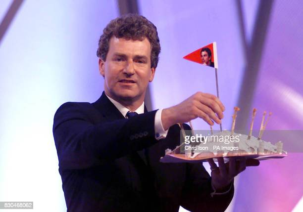 Shadow Secretary of State for Culture Media and Sport Peter Ainsworth with a model of the Millennium Dome during his speech on the second day of the...