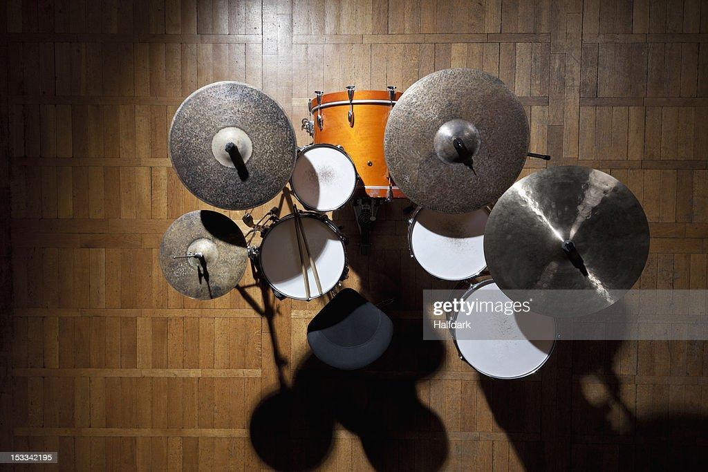 Shadowed drum kit on stage in spotlight