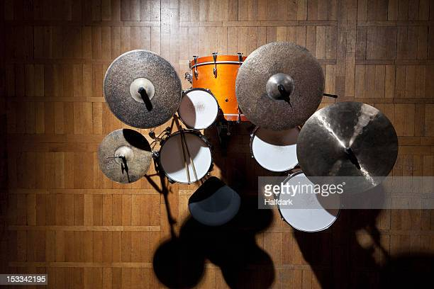 Shadowed drum kit on stage in spotlight