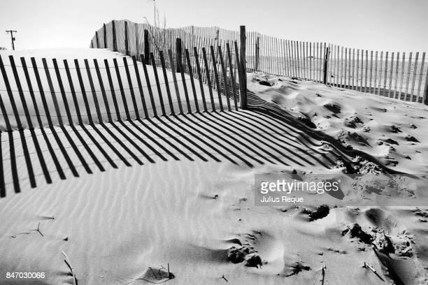 Shadows and footprints on a beach
