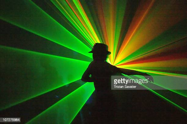 Shadows and Laser Lights in Rave Party