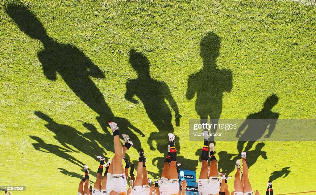 Shadows are cast by the Crows as they leave the field after losing the round two AFL NAB Cup match between the Geelong Cats and the Adelaide Crows at Simonds Stadium on March 2, 2013 in Geelong, Australia.