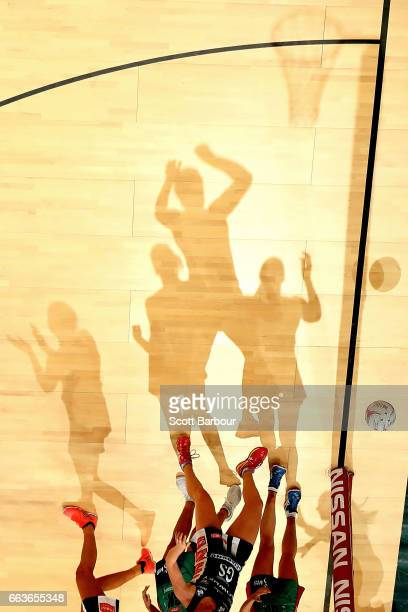 Shadows are cast on the floor as Caitlin Thwaites of the Magpies and Emily Mannix of the Vixens compete for the ball during the round seven Super...