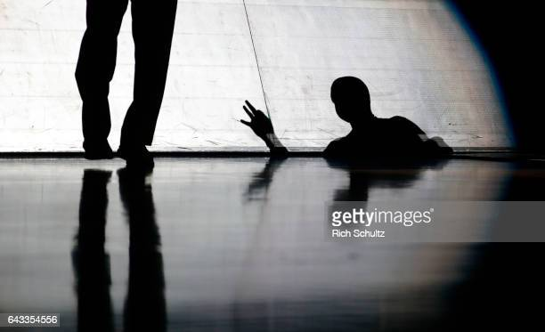 Shadows are cast on the scorers table during player introductions before the start of an NCAA college basketball game between the Villanova Wildcats...