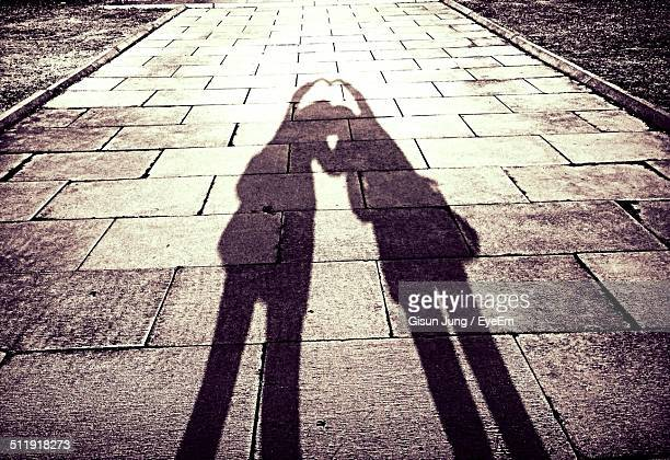 Shadows forming heart on street
