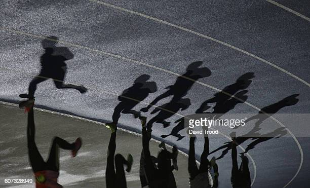 Shadows of a group of runners