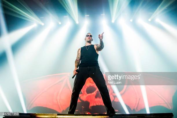 Shadows of Avenged Sevenfold performs on stage at Wembley Arena on December 1 2013 in London United Kingdom