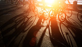 Shadows of bicycle  riders at dawn