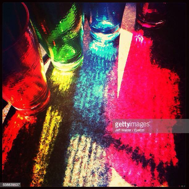 Shadows Of Colored Drinking Glasses