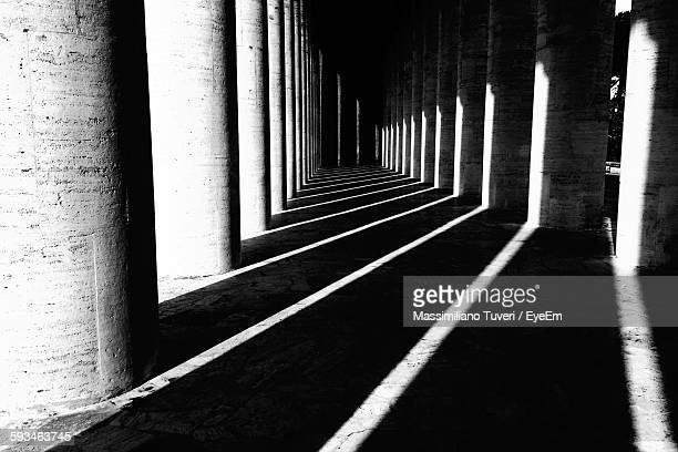 Shadows Of Columns Falling On Covered Walkway