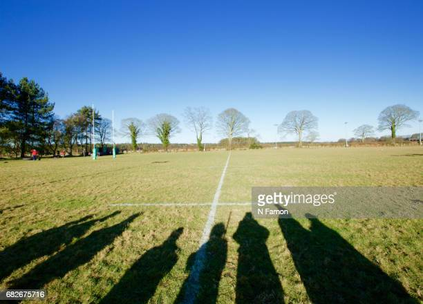 Shadows of crowd watching at a rugby match