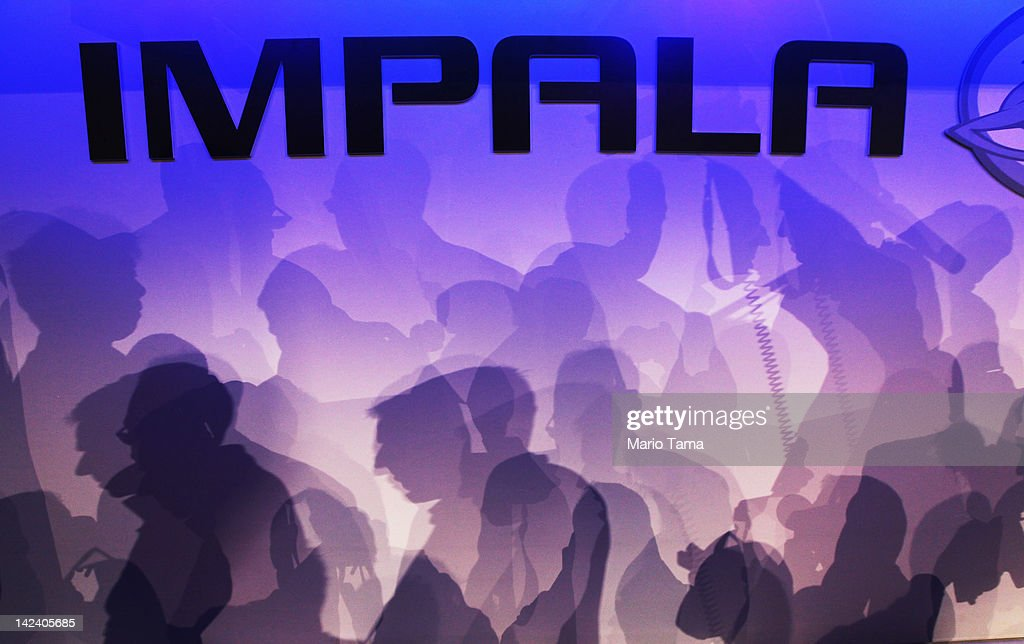 Shadows of media members are cast on a wall as they inspect the newly unveiled 2014 Chevrolet Impala at the New York International Auto Show at the Jacob Javits Convention Center on April 4, 2012 in New York City. The New York International Auto Show features nearly 1,000 brand new vehicles from all auto industry sectors and is open to the public April 6-15.