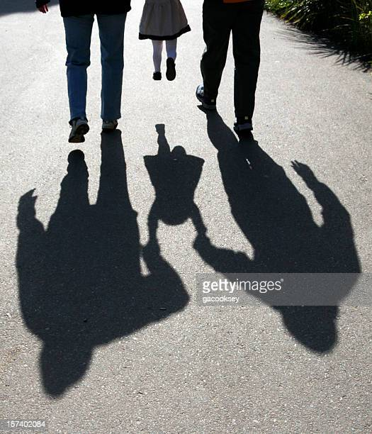 shadows of parents lifting child