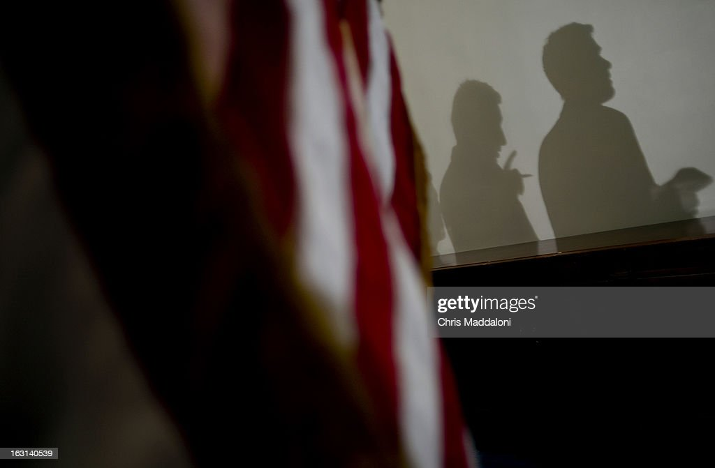 Shadows of reporters asking questions of Rep. Joseph Crowley, D-N.Y.; and Rep. Xavier Becerra, D-Calif., at a press conference on budget sequestration after the closed Democratic Caucus meeting.