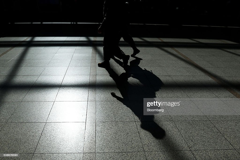 Shadows of South Korean Marine Corps soldiers are cast on a floor at Seoul Station in Seoul, South Korea, on Sunday, Feb. 7, 2016. North Korea launched a long-range rocket Sunday, just weeks after conducting a fourth nuclear test in the latest setback for international efforts to pressure the Kim Jong Un regime to end its weapons program. Photographer: SeongJoon Cho/Bloomberg via Getty Images