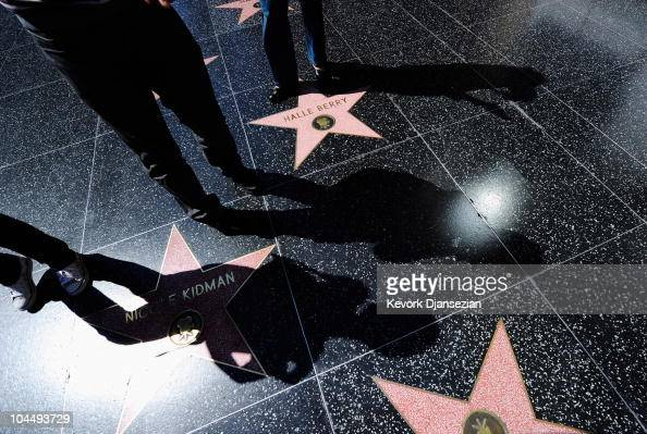 Shadows of tourist are cast on the Hollywood Walk of Fame on September 27 2010 in Los Angeles California The heat wave continues to bring hot...